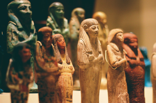 spinalskies:  Some pharaohs I think.  These are shabtis!  Shabtis are figures buried with the dead to help them with work in the afterlife. Ancient Egyptians believed that the afterlife had many similarities to the physical word, except it was forever and wonderful. For example, in the afterlife, Pharaohs, and other stately figures would still need  a cook a cleaner  a maintenance worker a cat guy Instead of sacrificing the real people who would do this in the physical world, they would have these lil' shabtis made to do their bidding in the afterlife. MORE on shabtis! Thanks for coming to the Museum!