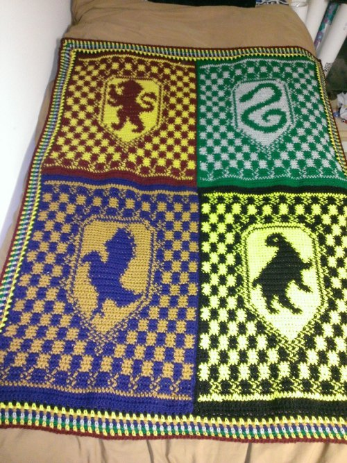 "letyourheartwait:  Just finished: Hogwarts House Crest Blanket Materials Used: Acrylic yarn (Red Heart and Vanna's Choice) I Hook Measurements: Approx. 37""x50"" Details: Crocheted using knitting charts (ravelry link) Edged in each house color"