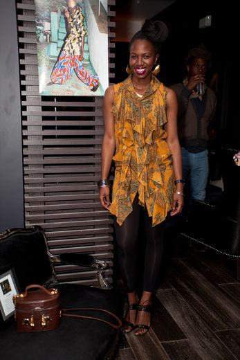 "STREET STYLE | Essence, ""Street Style: Pretty In Patterns"" December 30, 2011 - ""Enyinne Owunwanne, founder of Heritage 1960 and host of the 'New African Fashion' party, wears a pattern that dances to life on the ruffles of her golden blouse."" Continue reading here."