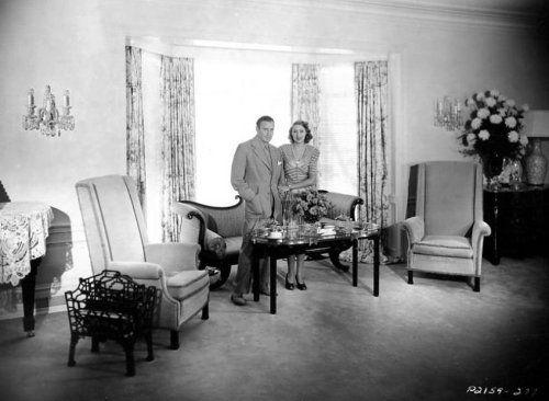 Original Caption: Jack Benny and Mary Livingstone in their living room, 1938.
