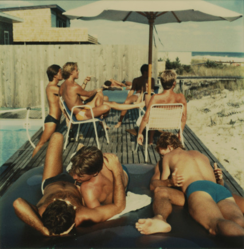 """mennameijer:  great polaroid series by tom bianchi. fire island pines - polaroids 1975-1983. """"The island is a 36 mile-long barrier a few miles off the Long Island coast, separated into small communities by extended open sand dunes. The Pines, which is one of these little villages, is a mile-long grid of boardwalks connecting about 600 houses built on telephone pole stilts sunk into the sand. Back then, some real-estate guys got to building on this virgin terrace, and it just so happened that the place began to attract bohemian New Yorkers; writers and artists would come out and live in little shacks. It wasn't intended for the gay community, but it made sense when it formed to be a home for it."""" """"these were personal transformation stories. It is this generation of men who are responsible for the whole gay pride movement. We developed this sense of community and started seeing ourselves as really special people, indispensable to the culture we lived in. And ultimately the one thing that brought us together was desire. We went to that place to get laid by guys who were fun and we were attracted to. We went for sex and we went for dancing. You danced until you found the partner that would fill your bed that night. Desire is more profound than gravity. Gravity just holds the planet together, desire brings human beings together so they can create things. The importance of nudity, the power of physical desire that brought us together, can't be overstated."""" """"We were kids, partying along, thinking we were untouchable, immortal. AIDS forced"""