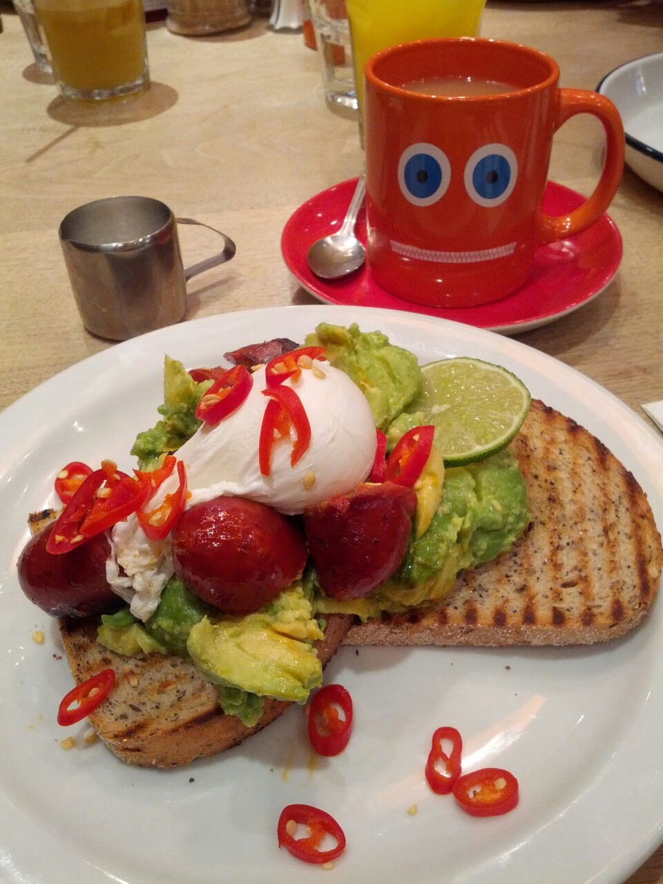 Avocado and eggs on toast @thebrekkyclub, of course I added chorizo
