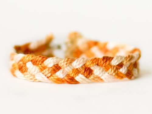 DIY Easy Five Strand Friendship Bracelet Tutorial from Flax & Twine here. Posting it on my kids' blog because the instructions are so easy to follow. You could change the hook and eye clasp to a tie closure.