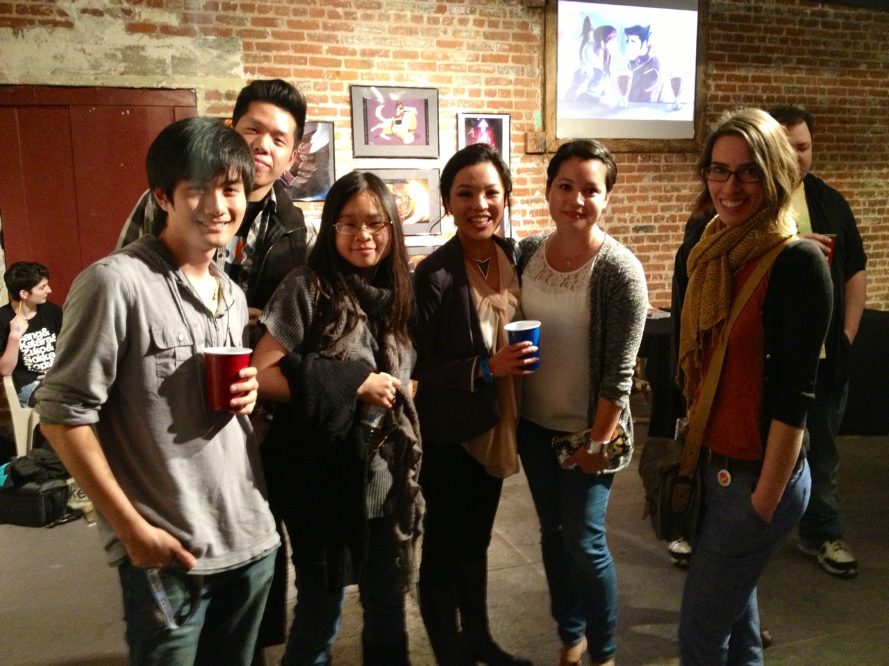 Some of the Korra crew at the Korra fan art show last night. What a great event! I really enjoyed all of the art and costumes, and meeting lots of nice, talented folks. Thanks to PixelDrip Gallery for organizing this, and to everyone who sent in their artwork! Very awesome and overwhelming! Love, Bryan  P.S. The event is still going on today, if you can make it. I won't be able to attend today, as I have a lot of non-fan Korra art to do, but they are still raffling off my Naga print, so I will be there in spirit.