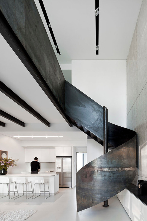 guawa:   designed-for-life:  Nam Dger Apartment by Gerstner Architects Nam Dger Apartment is a unique modern home situated in Nam Tower in the heart of Tel Aviv, Israel. The most intriguing feature about this home is its sculptural steel staircase as the focal point of the home. This two-level bachelor pad showcases sleek white interiors and modern furnishings of minimalist design.   q'd