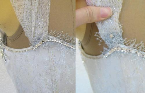 "anachronisminaction:  Silver Brocade Keyhole Plunge Corset with Sequins, Tulle, net and Heavy Crystal Decoration. Corset has coutil inner layer, lined in cotton sateen. Spiral and Flat 1/4"" bones through-out, 1/2"" flat steels at center front. Silver grommets and metallic gold lacing. Many of the crystals were generously donated by Swarovski. The remainder I purchased from Tutu.com and International Silks and Woolens. Colors include Clear, aurora borealis, white pan, moonlight and gold/white opal.I did not want to stress the delicate tulle strap, so I attached the back on a strip of silver elastic. The end is decorated with the same silver net, and crystals. The straps are also lined in a softer tulle for the comport of the wearer."