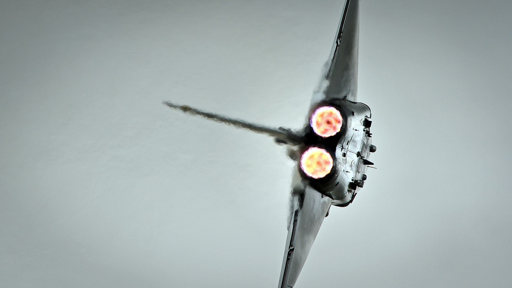youlikeairplanestoo:  Looking up the backside of a Typhoon with its burners lit. Photog Simon Gratien nailed this shot!