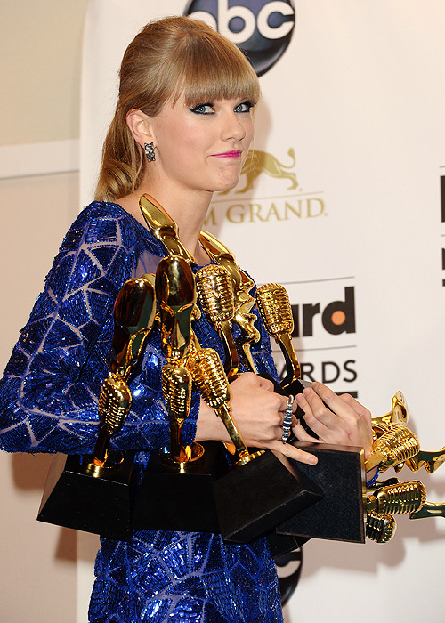 "taylortwister:  loveisforeverfearless:  ""Oh hey haters, I'm sorry…I can't hear you over my awards."" ""What can I say? I'm fucking fabulous. These awards agree."" ""I don't know, do you think we'll have room for these with all the others?""  no sweat, I'll  just buy a bigger house"