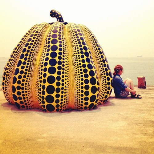 "instagram:   A Pumpkin by the Sea Want to see more? Visit the 南瓜 (黄色いかぼちゃ) and Benesse House location pages. On the tiny island of Naoshima in the Seto Inland Sea of southern Japan, artist Yayoi Kusama's ""Pumpkin"" (1994-2005) sits patiently at the water's edge. Instagrammers flock to the sleepy island to see a world-class art collection that was made possible in large part due to the philanthropy of Benesse Corporation, a Japanese company that specializes in test prep and language schools. Kusama's ""Pumpkin"" is perhaps the most photogenic artwork on the island, beckoning visitors to come closer and pose with the giant spotted squash that Kusama says represents her alter-ego."
