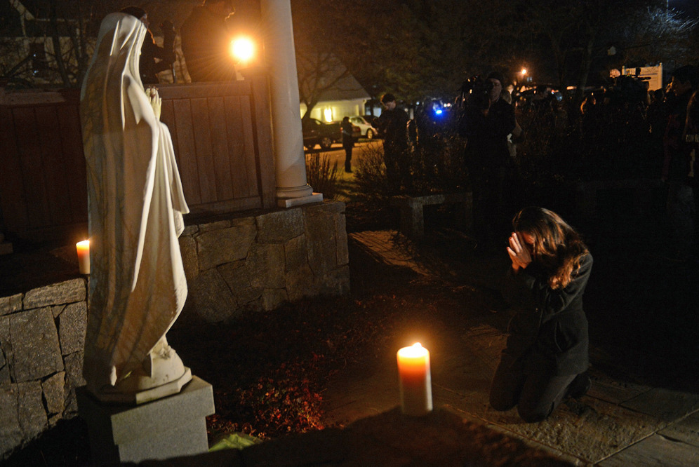 "nprradiopictures:  On the night of the shootings in Newtown, Conn., a woman named Aline Marie attended a prayer vigil at St. Rose of Lima Roman Catholic Church, which was packed with local residents and the media. After about 45 minutes, Marie saw the statue of Mary and knelt down to pray. ""I sat there in a moment of devastation with my hands in prayer pose asking for peace and healing in the hearts of men,"" she recalls. ""I was having such a strong moment and my heart was open, and I started to cry."" Her mood changed abruptly, she says, when ""all of a sudden I hear 'clickclickclickclickclick' all over the place. And there are people in the bushes, all around me, and they are photographing me, and now I'm pissed. I felt like a zoo animal."" What particularly troubles her, she says, is ""no one came up to me and said 'Hi, I'm from this paper and I took your photograph.' No one introduced themselves. I felt violated. And yes, it was a lovely photograph, but there is a sense of privacy in a moment like that, and they didn't ask."" On the other end of the camera was AFP photographer Emmanuel Dunand. Based in New York, he had arrived in Newtown that day. He says he was overwhelmed by the assignment of having to photograph residents during such extreme grief. ""I have two kids,"" he told me. ""It's the type of story you never want to cover, ever, and being a dad … all you want to do is put down flowers, you don't want to take photos."" But, he said, it was his job to make photos to help tell the story to the world, and in the midst of so much raw emotion, he tried to be discreet with his camera. If he sensed that someone was bothered by the camera, he simply put it down. What It Feels Like To Be Photographed In A Moment Of Grief Photo Credit: Emmanuel Dunand/AFP/Getty Images What are your thoughts? Should photographers interact with their subjects in moments of grief, or is it more respectful to leave them alone?  Interesting perspectives on the role/responsibility of a photographer."