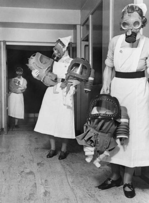 collectivehistory:  Gas masks for babies tested at an English hospital, 1940 (via Imgur)