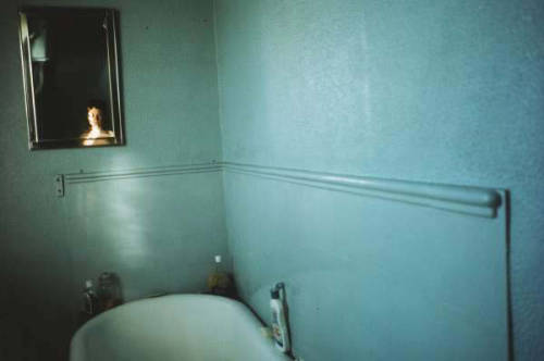 afterthenight:  Nan Goldin, Self-portrait in blue bathroom, London 1980