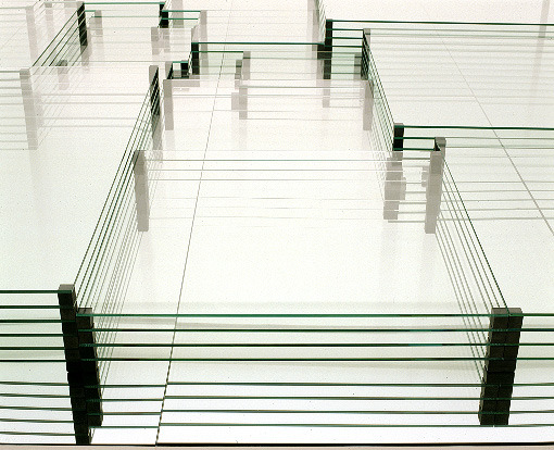 ephemeralol:  Carsten Nicolai perfect square 2004glass, aluminum, wood, rubber362 x 362 x 21cmwith stage elements400 x 400 x 50cm perfect square consists of an accumulation of glass sheets of various sizes which form a complex visual composition through the concept of layering. the division of the base follows the mathematical principle of the perfect square that divides a square in several smaller squares without repeating any one size. the smallest possible number of squares is 21. the russian mathematician a.j.w. duijvestijn discovered the principle of the perfect square in 1978. the work perfect square is expanding this principle to a three-dimensional form in which multiple layers of glass are arranged beside and on top of each other, resembling permanent storage media, and complexity and reflection take precedence as in a thought model.