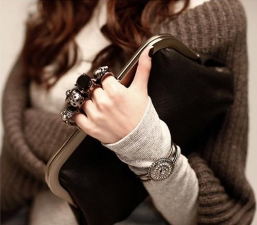 Add some flair and an edgy twist with this dazzling skull knuckle ring clutch. This piece is showcases a 4 ring clasp, each with a different style, and leather texture bag. The clutch also comes with a chain. Forget about your rings and carry this in its stead for an unforgettable accessory that is sure to leave an impression! http://yamakny.com/collections/bags/products/skull-knuckle-ring-clutch  XOXO, Yamak