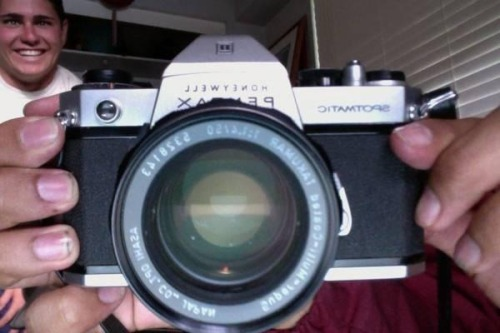 BUY THIS CAMERA! MESSAGE ME IF INTERESTED! :)  Honeywell Pentax Spotmatic camera in good working condition.  Lenses: Asahi 50mm 1.4 Vivitar 135mm 2.8 telephoto Vivitar 28mm 2.5 wide angle Automatic Tele-Converter 3x-1  Filters:Spiraton Vignetor 55mm Vivitar Macro Adaptor +10 49mm Vivitar 82A 55mm Vivitar Polarizing 55mm includes camera bag.  $125   MESSAGE ME :)   Shout out to Brian in the background.