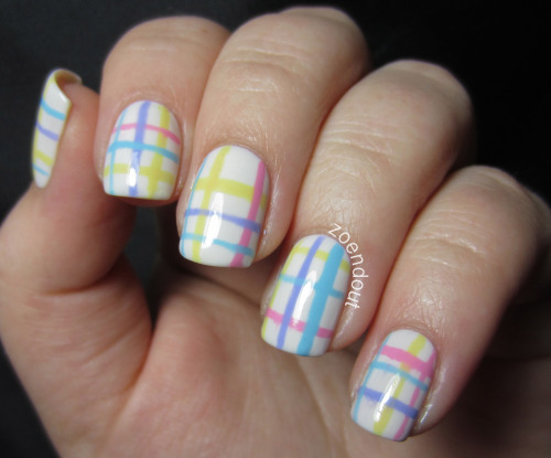 Here are the nails that I'll probably still have on for Easter, Pastel Plaid! Yep, I took the easy way out and just did some stripes, but it still really like these.   For these nails I started with a base of Shallow from Colour Gossip. I used the longest striper that I have for these. I started with the yellow, Sinful Colors Unicorn. The pink stripes are OPI Pink Friday, the purple stripes are Sinful Colors Candy Coated. Last but not least, the blue stripes are Sinful Colors Sugar Rush. I used two coats of top coat on these so they wouldn't feel lumpy.   I hope you guys have a happy Easter!