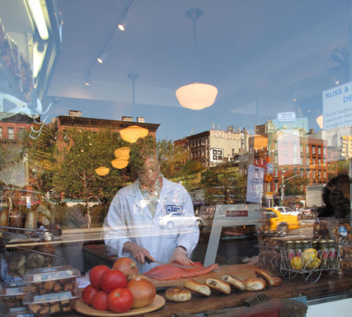 Niki Russ Federman, slicing smoked salmon, by hand, in the window, at Russ & Daughters.