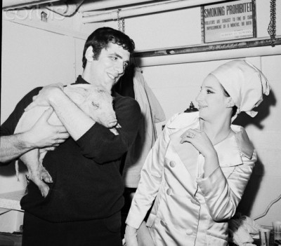 oldloves:  Actor Elliott Gould gives wife Barbra Streisand a piglet on her birthday as an opening night good luck charm. New York, 1966.