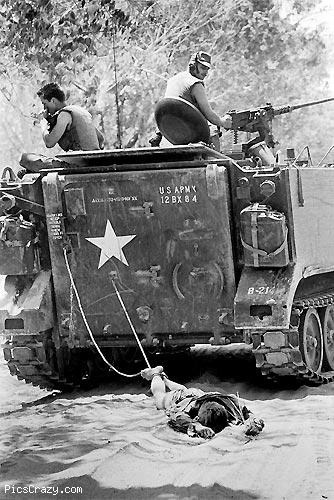 bandofbrotherslittlesister:  1966 U.S. troops in South Vietnam are dragging a dead Viet Kong soldier.