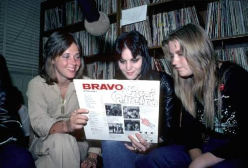 therunawaysfanclub:  Singer Suzi Quatro with  Joan Jett and Vicki Blue of the rock band 'The Runaways' check out Suzi's new record 'Can the Can' in the Los Angeles, CA studios of radio station KROQ FM in August of 1977. (Photo by Michael Ochs)