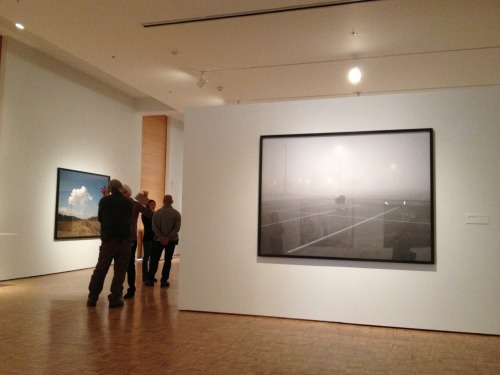* Awesome: Viewing the new Richard Misrach exhibit at the Cantor Arts Center. * Only slightly less awesome: Wondering what the heck this guy was talking about. Photo by me, hence the out-of-focusness.
