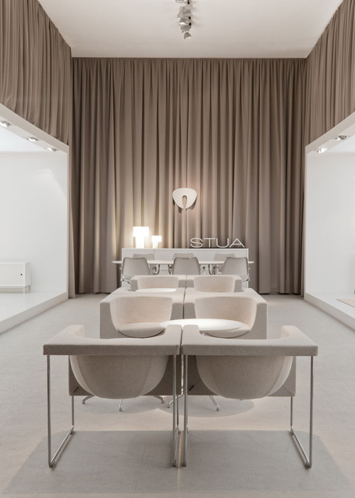 "The STUA stand in the Milano fair, with ""love your home"" concept. This central area is a beige and calm chill out area with Nube arcmahirs from the STUA collection. STUA Design Etc"