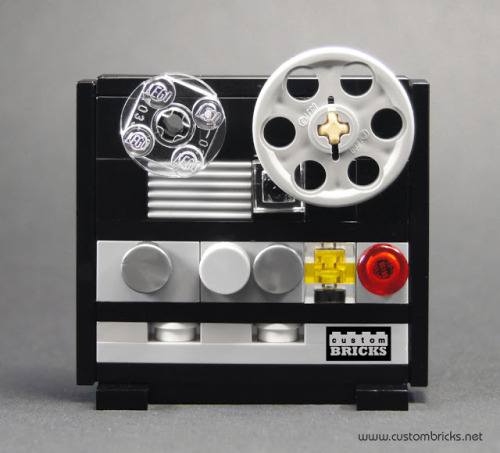 thingsmagazine:  Lego reel to reel  Cute. Nice use of the transparent plates and the relatively new 1x1 round tiles.