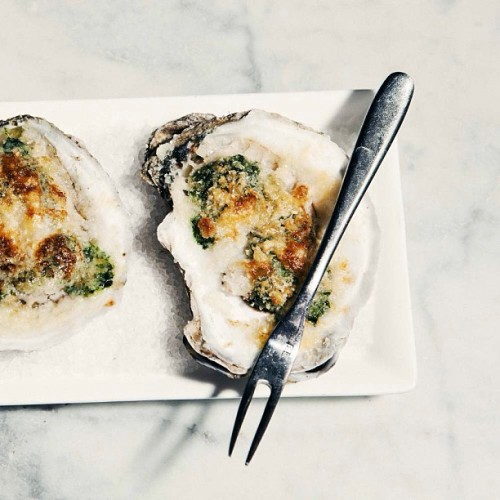 April Bloomfield's Oysters Rockefeller are topped with garlic, lemon, butter, and finely chopped spinach, then sprinkled with bread crumbs that toast up in a fleeting moment under the broiler. Photograph by Joao Canziani