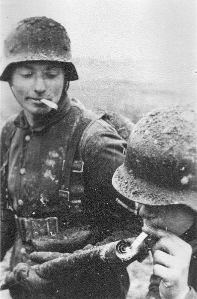 ryanandthecrew:   German army soldiers - lighting a cigarette with a flamethrower