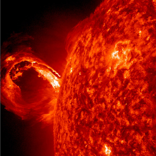 ikenbot:  Circular CME  A corona mass ejection (CME), associated with a solar flare, blew out from just around the edge of the Sun today in a glorious roiling wave (May 1, 2013). The video, taken in extreme ultraviolet light by NASA's Solar Dynamics Observatory spacecraft, covers about 2.5 hours. SOHO's C2 and C3 coronagraphs shows a large, bright, circular cloud of particles heading out into space. STEREO spacecraft, from their different perspectives in space, observed the flare. CME's carry over a billion tons of particles at over a million miles per hour.