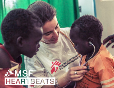 Photo: MSF doctor Claire Marie Loys introduces a young patient to his heartbeat in Aweil, South Sudan. Photo by Yann Libessart/MSF Dr. Loys and her team provide maternal and child health at the Aweil referral hospital; over the last year more than 4,700 children have received treatment there.