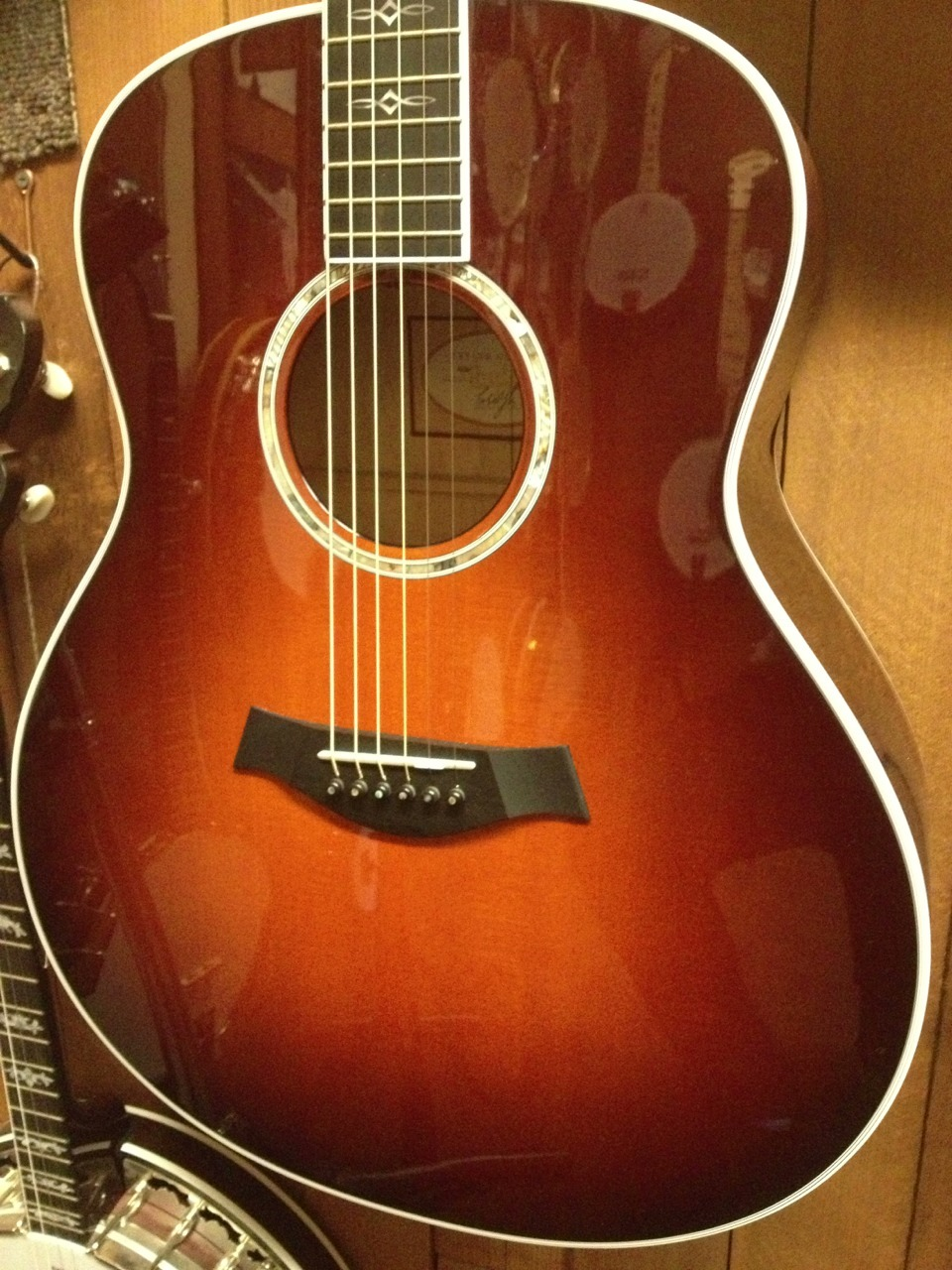 Taylor 618-E Sunburst New w/Case Quilted Maple/Sitka Spruce MSRP: $4439.00 Ours: $3329.00