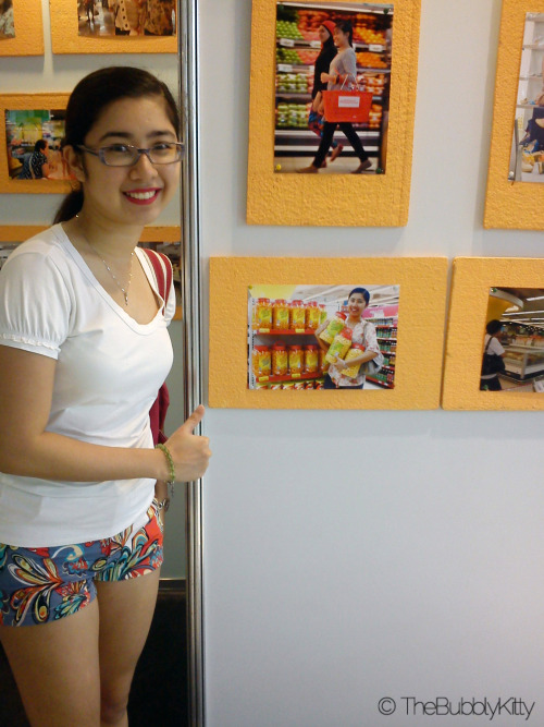 Look look! I saw a photo of me by @karlamisa at Abreeza near the groceries section! Weee. It's a picture of my holding lots of corn balls. Lol XD
