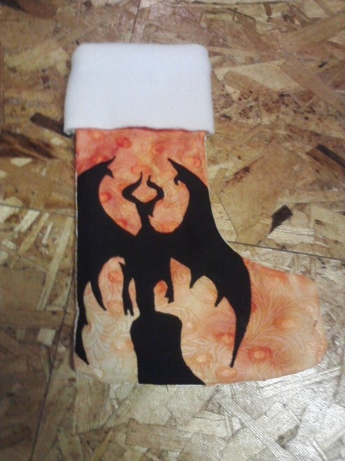 snowtigra:  Planeswalker Stockings! So the story behind these is that an old coworker of mine was rediscovered many years later and opened a tabletop gaming store with food in Minnesota called Your Mom's Basement.  The place rocks!!  The fact that he's gone so far as to open his own business and such is hugely inspiring so I keep wanting to make things for the place.  He requested, for Christmas, a set of Christmas stockings to decorate the store's fireplace with from Magic the Gathering.  He gave me the character names and here's what I came up with ^_^