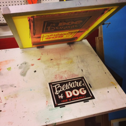 "Working on some screenprinted versions of the ""Beware of Dog"" sign I painted for Carnegie a few weeks ago. ""He is adorable"" version coming later this week, and then on Etsy soon"