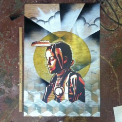 Mixed media on ply by: Cheyenne Randall. Part of Shepard Faireys & Aaron Hueys work as the center piece.