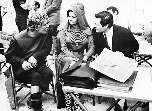 Marcello Mastroianni visits Sophia Loren and Charlton Heston on the set of El Cid, 1961.