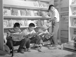 "bygoneamericana:  Four young evacuees from Sacramento, California read comic books at the newsstand in the Tule Lake Relocation Center. Newell, California, 1942.   The ""evacuees"" are Japanese Americans, forced into an internment camp. The one on the left is reading MARVEL MYSTERY COMICS #34, which contains the stories ""Exposed! The Jap Invaders"" and ""Dr. Watson Makes Monkeys Out of the Japs."""