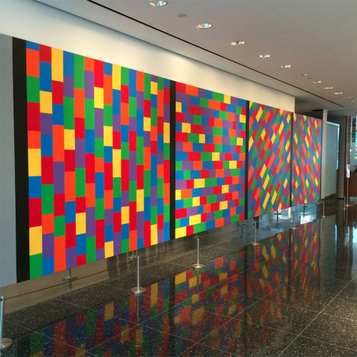moma:  Sol LeWitt was born today in 1928. Visit this wall drawing the next time you're at MoMA. It's located on the first floor near the film entrance and The Modern restaurant.   [Sol LeWitt. Wall Drawing #1144, Broken Bands of Color in Four Directions. 2004]