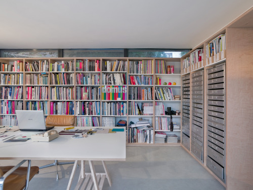 built-in bookshelves and flat files (Photo by Andrew Meredith, via Dwell)