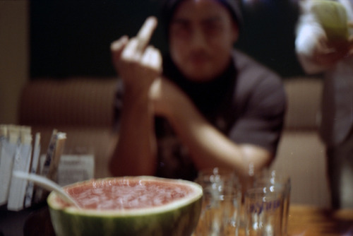 15 on Flickr.Watermelon shochu and fuck you. Canon a1. Expired Fuji 100. 35mm.