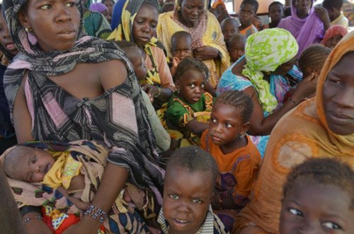 "Photo: Malian refugees fleeing conflict in Mali arrive at the border in Fassala, Mauritania. Mauritania 2012 © Lynsey Addario/VII Desperate Conditions in Camps Causing Disease Among Malian Refugees Conflict in northern Mali is still forcing large numbers of people to flee their homeland and seek sanctuary elsewhere in the countries of the Sahel region, but the conditions in the camps where they are living are themselves leading to disease and suffering.According to UNHCR, approximately 150,000 Malian refugees are living in camps in Burkina Faso (Ferrerio, Dibissi, Ngatourou-niénié, and Gandafabou camps), Mauritania (Mbera camp), and Niger (Abala, Mangaize, and Ayorou camps). Doctors Without Borders/Médecins Sans Frontières (MSF) has been working in these eight camps since March 2012, providing primary and maternal health care and treating malnutrition. MSF is also vaccinating children between six months and fifteen years old for measles. Nearly 12,000 consultations and 5,000 vaccinations have been carried out since the beginning of the year. Nearly 67,000 refugees—mainly women and children—have arrived in the border town of Fassala, Mauritania, since January 2012. ""At the border crossing at Fassala, Mauritania, people are arriving thirsty and showing signs of fatigue,"" explains Karl Nawezi, MSF project manager in Mauritania. After being registered by the authorities, refugees wait in a transit camp before being transferred to Mbera, a small, isolated village in the Mauritanian desert, just 30 kilometers [about 19 miles] from the Mali border."
