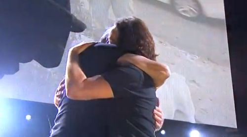 Eddie Vedder and Roger Waters hugging.  5 Awesome Performances From The 12-12-12 Show