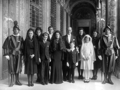 The Kennedy Family at the Inauguration of Pope Pius XII Today, foreign dignitaries gathered from around the world to watch Pope Francis be inaugurated as the 266th Pope of the Catholic church. As the Ambassador to Great Britain in 1939, Joseph Kennedy and his family attended the same event for Pope Pius XII. Pictured here, the Kennedy family gathers for a quick photo-op before the ceremony. Pictured (left to right, back row) Patricia Kennedy, John F. Kennedy, Joseph P. Kennedy, Eunice Kennedy, Rosemary Kennedy, (left to right, front row) an unidentified Vatican guard, Kathleen Kennedy, Robert F. Kennedy, Rose Kennedy, Edward M. Kennedy, Jean Kennedy and unidentified Vatican guard. -from the JFK Library
