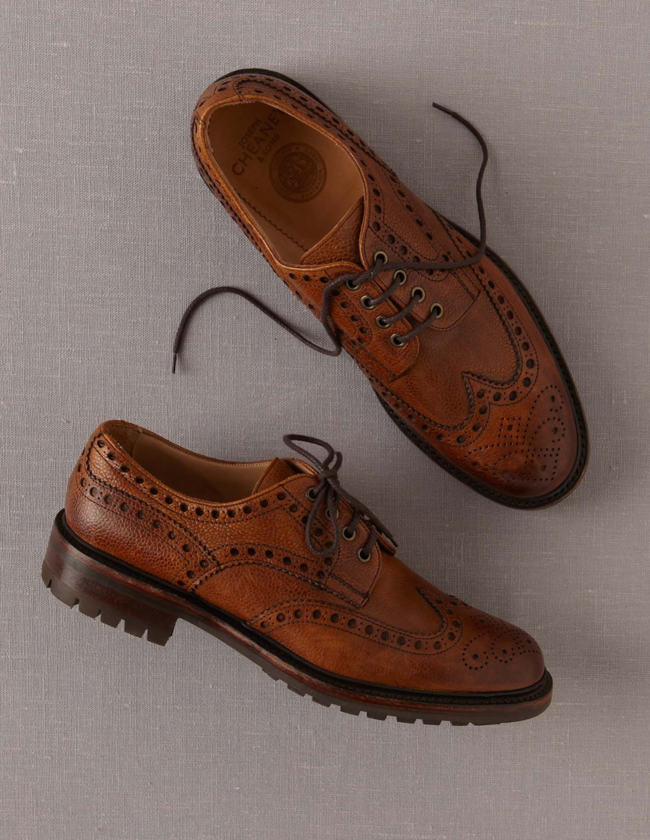 A brogue and a brogue country boot in grain calf leather, hand crafted in Cheaney's Northamptonshire factory, England.