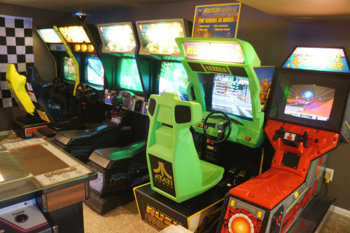 thedrunkenmoogle:  The Basement Arcade There are cool basement bars and then there is this basement arcade bar. Redditor Mertzlufft and his father built this incredible arcade in their basement, housing 42 arcade games! Games random from the original Donkey Kong, to Hydro Thunder, to Galaga and everything is set to free play. The bar in the center looks to be the perfect place to start out. A night of cocktails and arcade games awaits. (via Reddit)