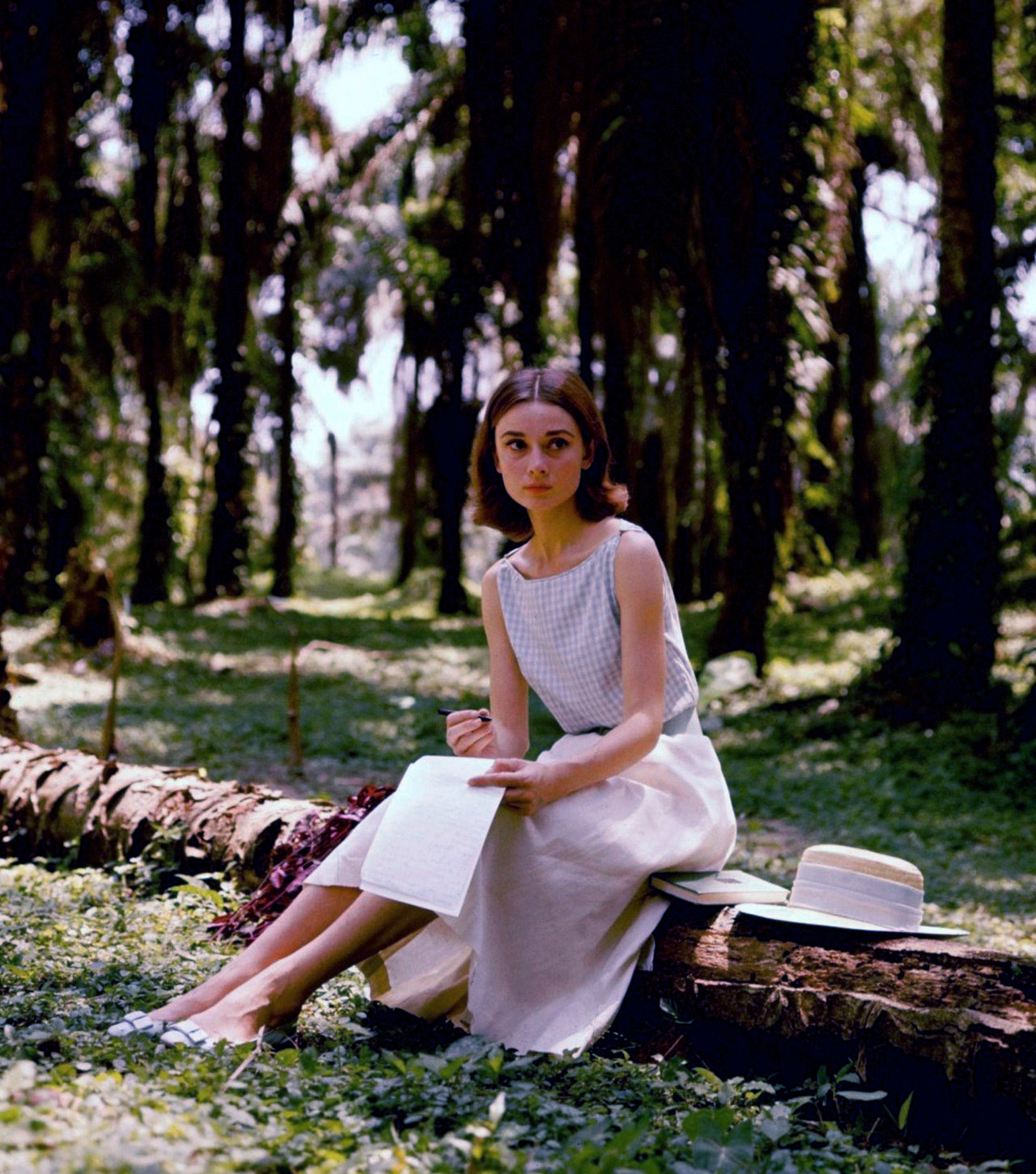 Audrey Hepburn in the Belgian Congo, 1958.  Special appearance by Audrey's yorkshire terrier aptly named Famous. Photographs by Leo Fuchs.