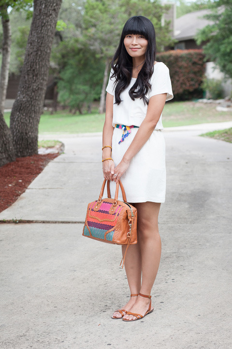 2013. LWD. late afternoon dress and boardwalk sandals by madewell. thrifted sash. rebecca minkoff bombe bag.on saturday we worked in the yard— michael got two truckloads of mulch, and we spread it all over the front and side flower beds. then we decided to buy river rocks and made a nice pathway to our back porch. after being in the sun for hours, i cleaned up and put on a little white dress. we went on a fancy outing to… the grocery store.but i kind of love that about a LWD. don't save them for weddings or parties. don't put them away after labor day. wear them whenever you want because they're simply perfect.the look | similar dress | sandals