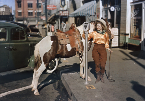 A cowgirl puts a nickel in an El Paso parking meter to hitch her pony, October 1939. Photograph by Luis Marden, National Geographic via: natgeofound