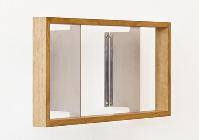 enochliew:  Regal Shelve by Das Kleine B Made from oak and 2mm stainless steel angles as wall mounts which disappear between the pages of a book.